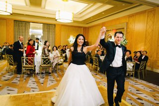 bride-in-a-strapless-vera-wang-gown-with-a-black-bodice-and-white-skirt-with-groom-in-black-tuxedo