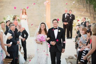 wedding-guests-toss-pink-petals-on-newlyweds