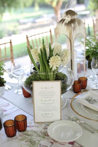 menu-card-on-display-at-garden-table-with-lantern