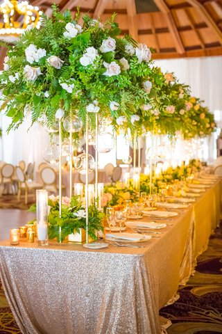long-table-tall-foliage-arrangements-shiny-linen-wedding-hotel-del-coronado-sequins-ballroom