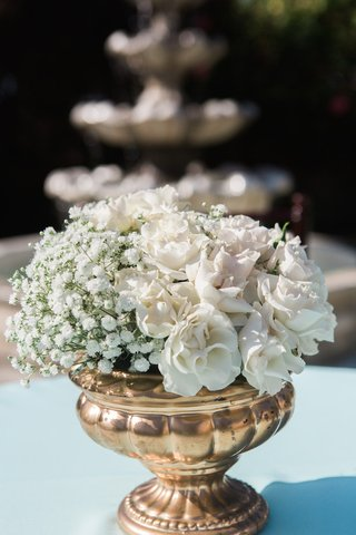garden-wedding-cocktail-hour-with-babys-breath-white-roses-in-golden-urn