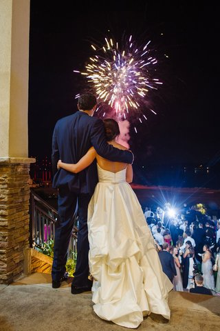 bride-and-groom-watch-fireworks-and-their-guests-wedding-reception-surprise