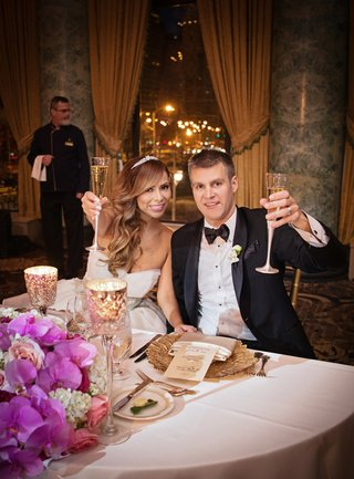 newlyweds-bride-and-groom-toast-champagne-the-drake-gold-coast-room