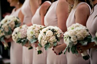 bridemaids-standing-in-line-at-church-ceremony-pink-dresses-pink-and-ivory-bouquet-flower