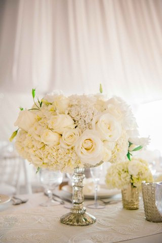 beach-tented-wedding-reception-table-with-embroidered-runner-ivory-roses-hydrangeas-in-silver