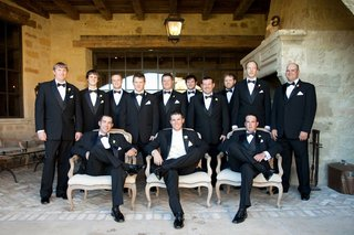 groom-with-best-man-on-chair-and-standing-groomsmen