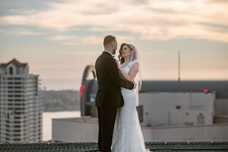 wedding first look at sunset before wedding reception rooftop in san diego westin