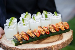 wood-slice-tray-with-mini-tacos-and-margaritas-with-salt-and-lime-at-outdoor-cocktail-hour