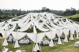wedding reception at klentner ranch in california white drapery round tables colorful design