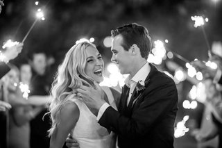 black and white photo of bride and groom at reception timeless wedding