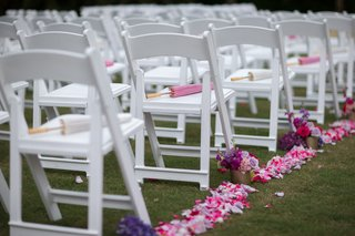 pink-lavender-magenta-rose-petals-line-aisle-parasols-on-chairs-at-wedding-ceremony