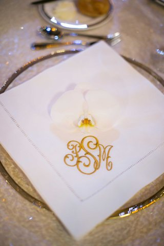 white-reception-napkin-monogram-in-gold-couple-orchid-pittsburg-catholic-wedding