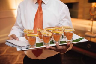 server-tray-passing-tomato-soup-in-shot-glasses-with-mini-grilled-cheese-sandwiches-on-top