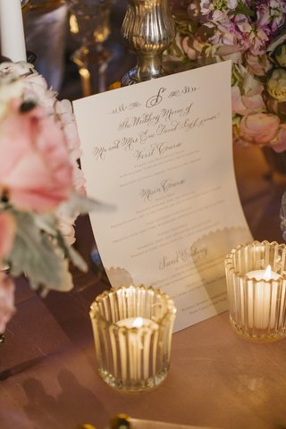 white-menu-card-with-calligraphy-and-gold-lettering
