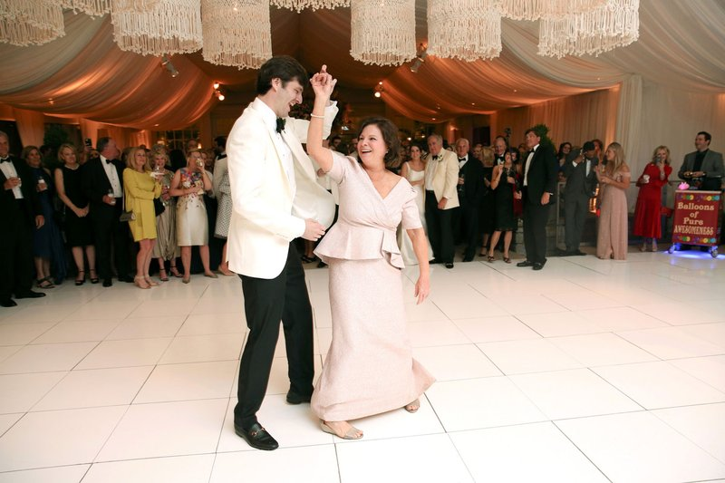 Groom Dancing with Mother at Wedding