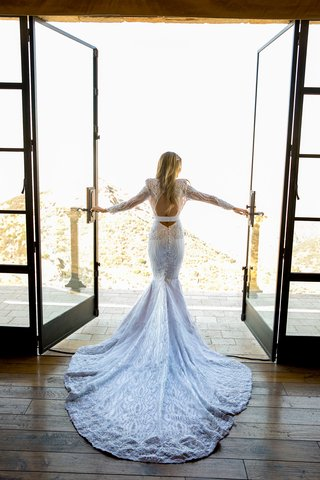 wedding dress bride looking out window canyon mountain view custom michael costello wedding dress