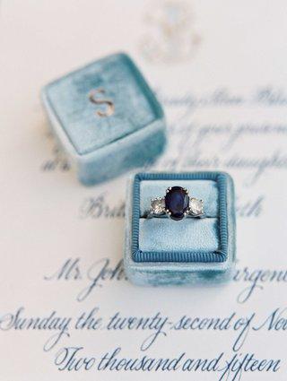 light-blue-velvet-mrs-box-with-three-stone-heirloom-diamond-ring-with-blue-oval-sapphire-center