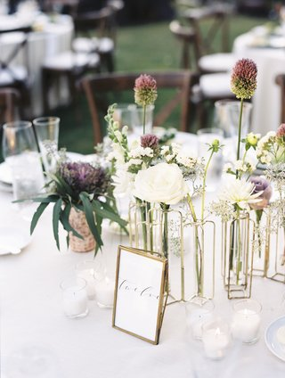 gold-bud-vases-with-unique-flowers-at-wedding-table