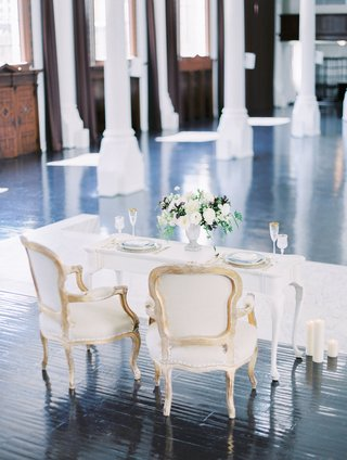 sweetheart-table-with-vintage-chairs-on-vibiana-dark-hardwood-floor-stage