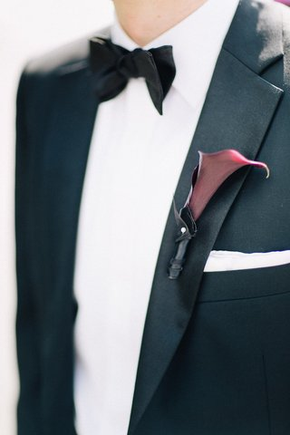 burgundy-calla-lily-boutonniere-on-groom-tuxedo