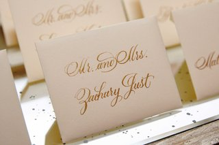 white-stationery-with-gold-calligraphy-for-elegant-escort-cards