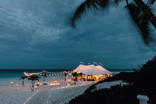 wedding-reception-under-tent-on-beach-destination-wedding-harbour-island-bahamas-sunset-lantern