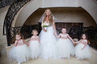 bride-in-hayley-paige-with-four-flower-girls-in-fluffy-tulle-skirts