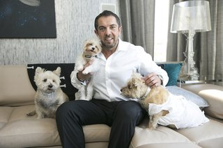 groom-in-white-button-down-with-black-pants-and-three-little-dogs-one-wears-a-white-dress
