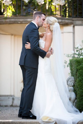 a-bride-and-groom-share-their-first-kiss-as-a-married-couple-at-an-estate-in-northern-california