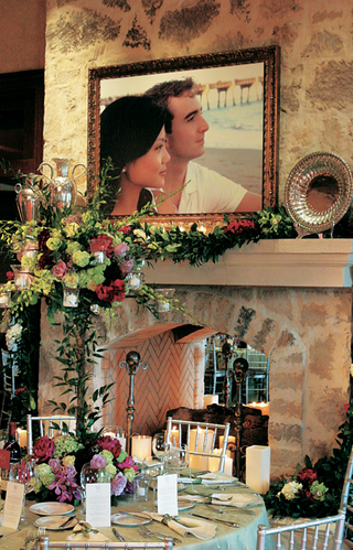 framed-photos-of-the-bride-and-groom-decorate-the-reception