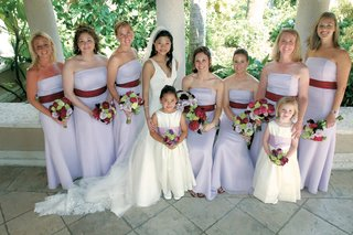long-strapless-bridesmaids-dresses-in-lavender-and-red-sashes