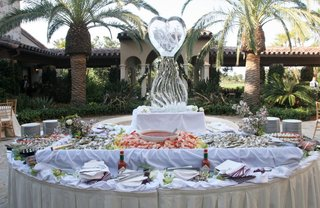 seafood-appetizer-table-with-a-monogrammed-ice-sculpture