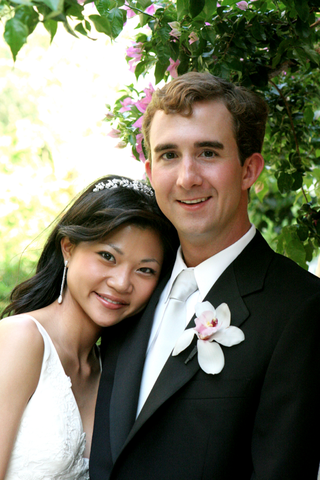 bride-wearing-a-diadem-and-diamond-drop-earrings-and-groom-in-tuxedo-with-silver-tie-and-orchid