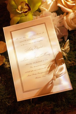 calligraphy-script-invitation-with-bow-in-corner