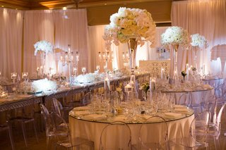 white-reception-concept-clear-elements-glass-vases-tall-florals-long-round-tables-pelican-hill