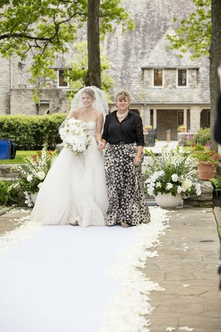 mom-black-white-gown-escorts-bride-down-aisle-wedding-outdoor-custom-garden-petals