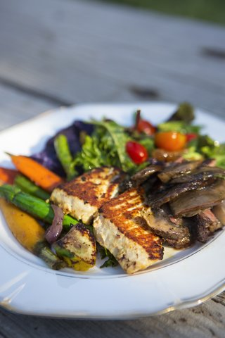 salad-and-vegetables-with-grilled-fish-on-plate