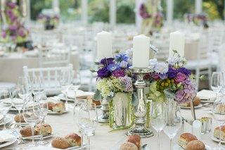 mercury-glass-candlesticks-next-to-purple-flower-centerpiece