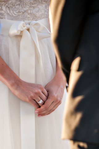 bride-in-monique-lhuillier-dress-with-diamond-engagement-ring
