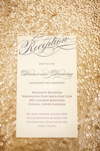 gold-sequin-background-with-blue-and-white-reception-card