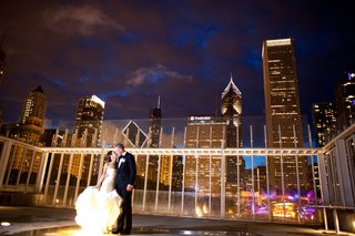 bride-in-vera-wang-gown-groom-in-j-crew-chicago-skyline-at-night