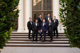 groom-in-navy-tuxedo-groomsmen-in-black-tuxedo