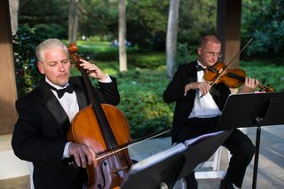men-playing-violin-and-cello-in-tuxedos