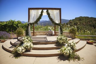 rustic-wedding-chuppah-with-garland-on-fabric-at-ranch