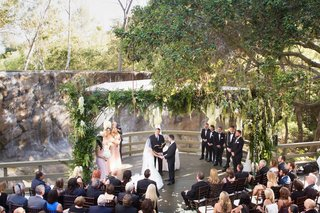 ceremony-oak-room-in-calamigos-ranch-in-malibu-ceremony-in-front-of-stone-waterfall-large-chuppah