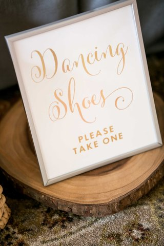 wedding-signage-dancing-shoes-gold-calligraphy-wooden-slab-tree-trunk