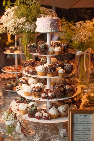 white-multi-tiered-stand-with-variety-of-cupcakes
