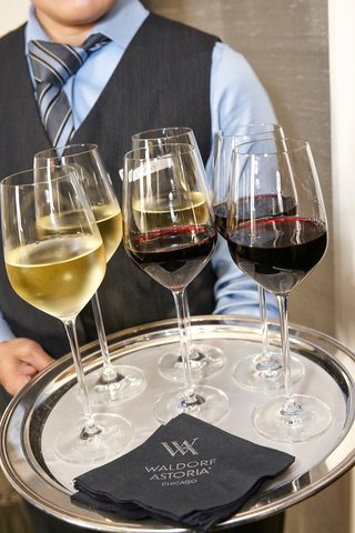 waldorf-astoria-chicago-server-with-a-tray-of-wine-glasses-white-and-red-glasses