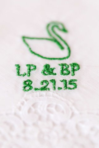 green-swan-embroidery-on-white-handkerchief-with-wedding-date-initials-and-swan
