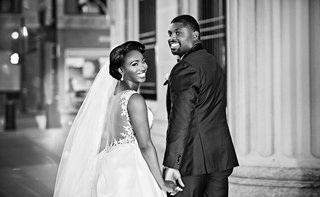 black-and-white-photo-of-african-american-couple-getting-married-in-chicago-bride-in-illusion-back